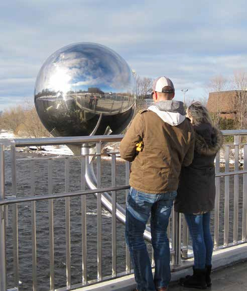 "The Adàwe Footbridge's public art took the form of two large reflective spheres. The Clegg-Fifth footbridge will have two ""art benches."" Photo by John Dance"