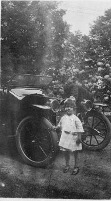 Betty, 3, posing in front of the family car, circa 1919. We don't know if the vehicle pictured is the family's Model T-Ford or their Hupmobile. Photo Courtesy of Brown Family Archives