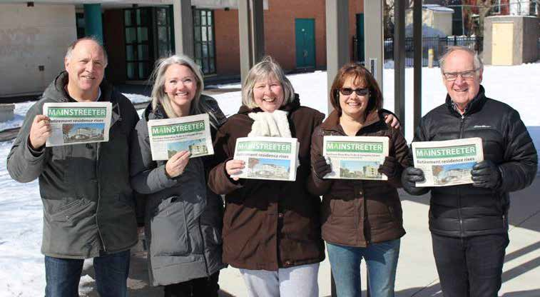 Some members of Team Mainstreeter brandish their favourite community newspaper outside of Lady Evelyn School. L to R: Lorne Abugov, Mainstreeter Editor; Meredith Newberry, former Mainstreeter Editor and Reporter; Bonnie Wepler, Mainstreeter Board Member and Reporter; Cynthia Dwyer, Mainstreeter Board Member and Accounts Manager, and Ron Rose, Mainstreeter Board Member (ex officio) and Advertising Manager