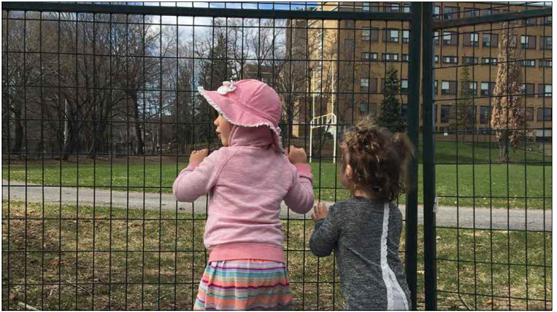 Newly erected barricade around Immaculata High School sports field leaves neighbourhood youngsters on the outside looking in. Photo by Carly Lang