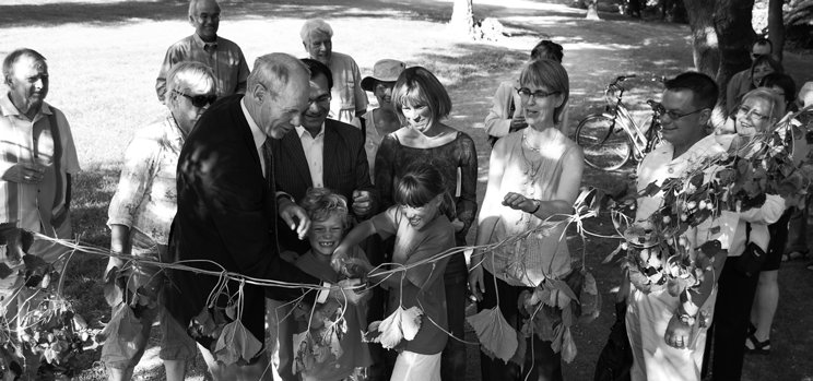 Former Capital Ward councillor Clive Doucet helps a group open a portion of the Rideau River Nature Trail in 2009. Photo by John Dance