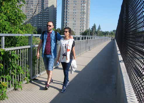 Lees Avenue residents Wajdi Zayami and Salma Ait Ammar are pleased the Rideau River Transit Bridge's pathway is again open. Photo by John Dance