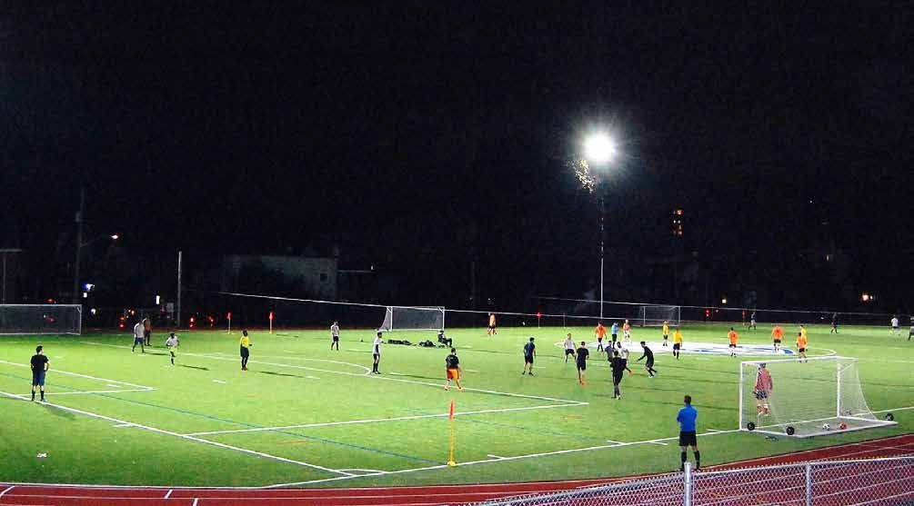 Footy Sevens intensive usage of the new turf field at Immaculata add bright lights, shrill referee whistles and new traffic concerns to the OOE nightscape. Photo by John Dance