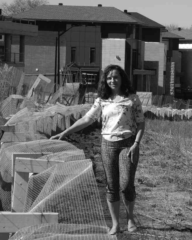 "Alexandra Gruca-Macaulay is the new chair of Sustainable Living Ottawa East (SLOE) and is pictured here beside the new ""turtle fence"" built by the Regional Group to ensure our neighbourhood snapping turtles don't stray into the construction area and lay their eggs. Photo by John Dance."