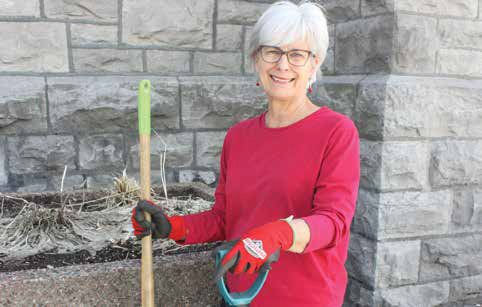 Linda Pollock beside a planter at Centretown United Church where she initiated an urban produce garden to help feed clients at Centre 507. Photo by Theresa Wallace.