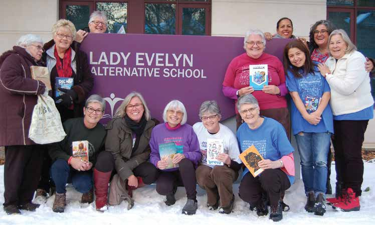 Bottom row (kneeling): Christian Hurlow, Lori Fraser, Lynda Jane Cornelisse, Nancy MacDonald, Marion Brearly; Middle Row: Barbara De Lorme, Heather Beausoleil, Barbara Cooper, Donna Bondy, Danielle Fontaine, Kathy Czerny; Behind the Sign: Lynn Champagne, Shari Langevin. Photo by John Dance