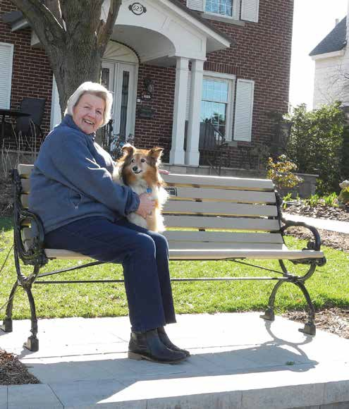 Dona Bowers and her dog Sandy enjoy the Echo Drive bench she had installed in honour of her late husband, Bob Gagnon. Photo by John Dance