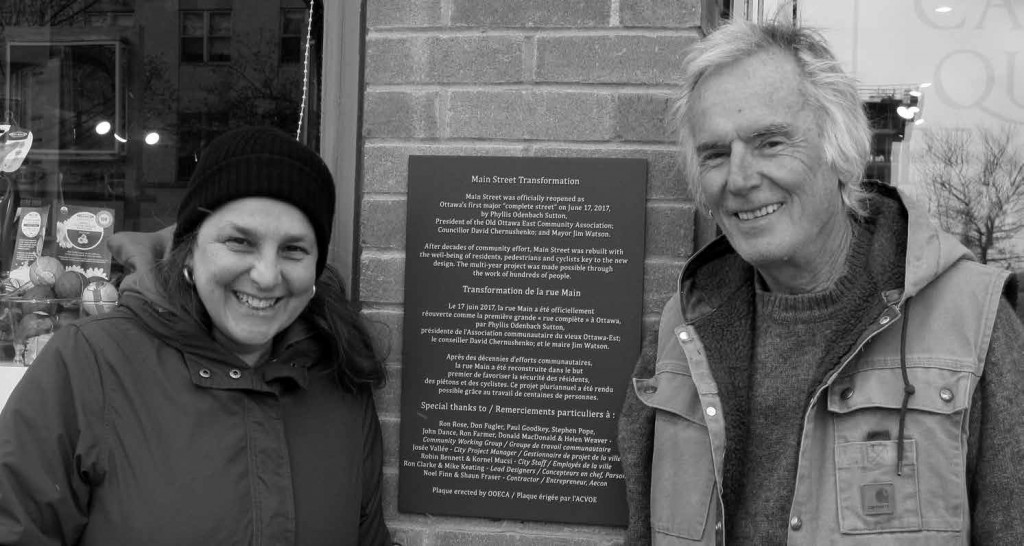 Helen Weaver and Ron Farmer represented Main Street businesses during the lengthy consultations on rebuilding Main Street and they are among those recognized by the new Main Street Transformation plaque between Singing Pebble Books and Café Qui Pense. Photo by John Dance
