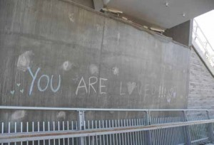 "In the midst of pandemic anxiety and BLM awareness, he message ""You are loved!!!"" appeared in pastel chalk on the OOE-side abutment. Photo by John Dance"