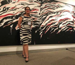 Tara Lapointe of Canada Council for the Arts seen here matching the artwork at the Art Bank. Artwork: Jacques Hurtubise, Nathalie (1980), acrylic and charcoal on canvas. Photo by Christopher Davidson