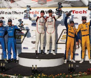 Zacharie Robichon (center right) and his teammate Dennis Olsen (centre left) of Norway celebrate a victory at the IMSA WeatherTech GTD championship at Lime Rock Park in Connecticut July 2019. Photo by Lessen Photo