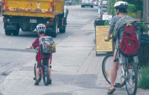 Active transportation infrastructure has improved greatly in central Ottawa since the above picture of Main Street cyclists was taken eight years ago. Photo by John Dance